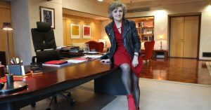 The image shows Mrs Maris Luisa Carcedo, Spanish health minister, in her office room