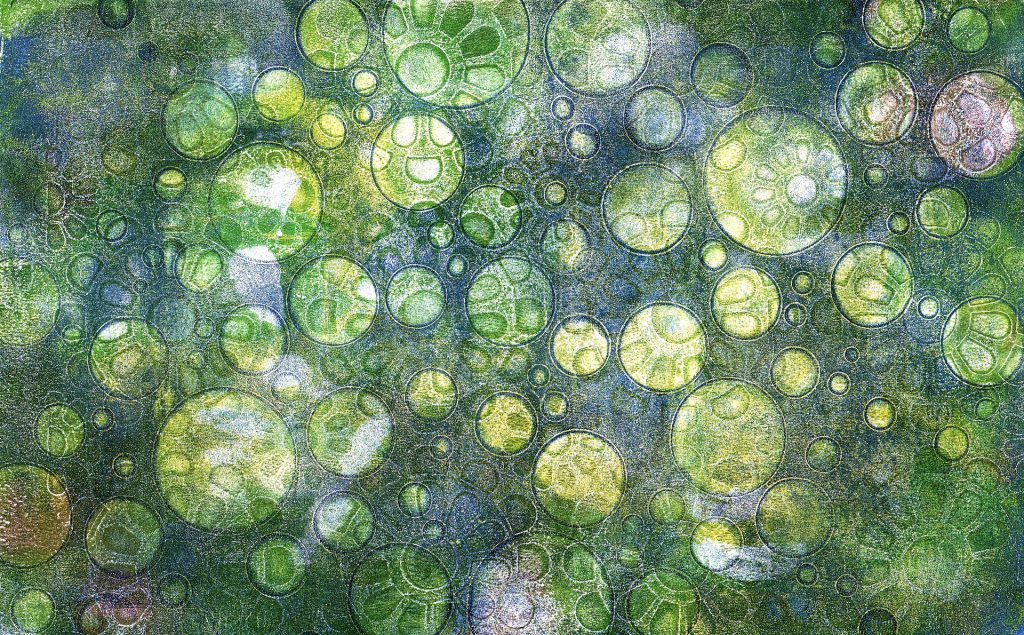 Illustrative picture - bubbles in charging green tones symbolizing globules as well as germs