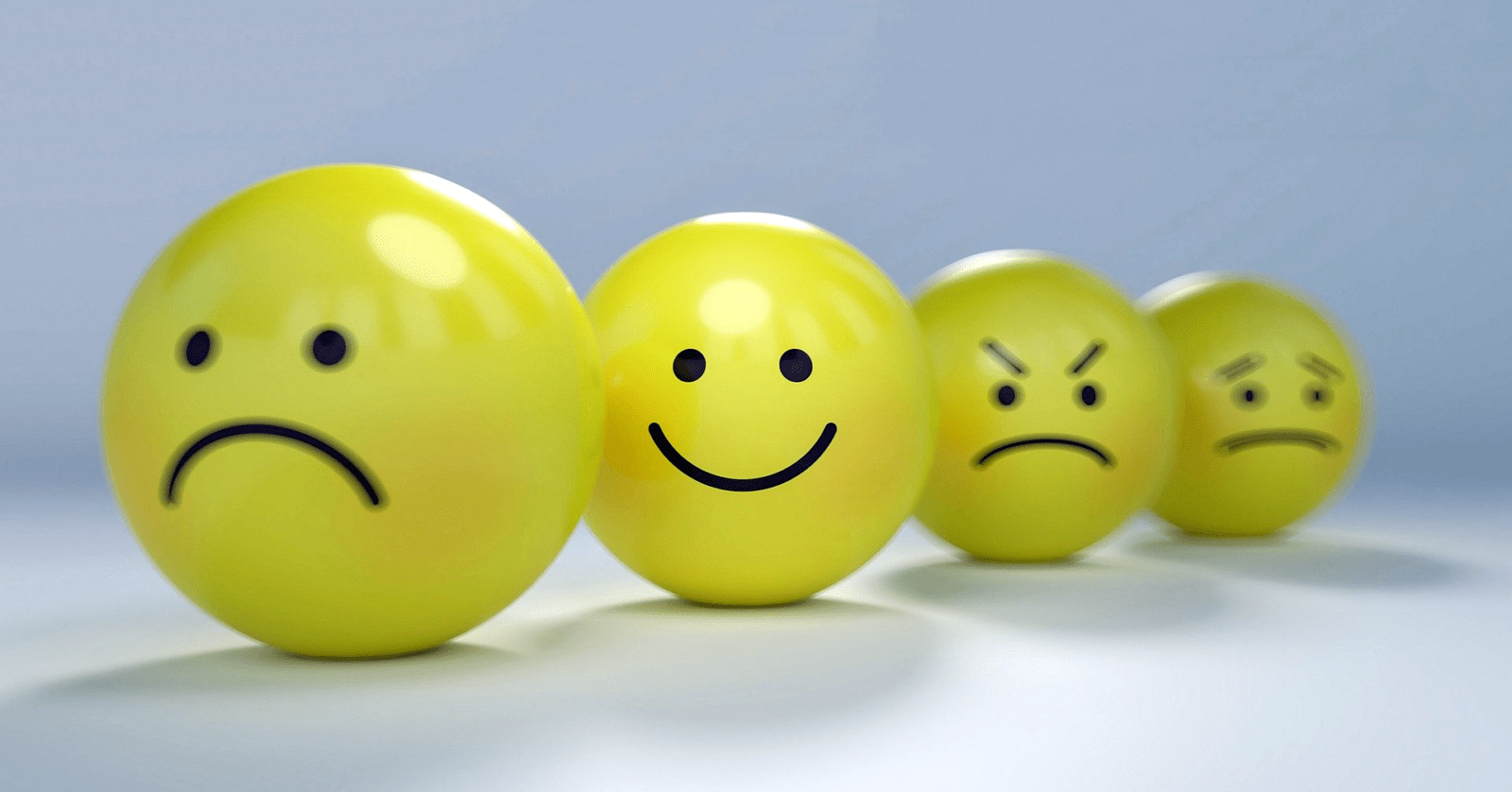 Four smileys - just one happily